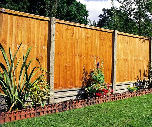 Wooden fence with concrete posts